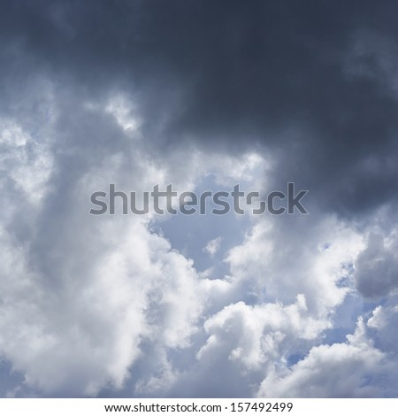 Sun hidden behind the rain clouds composition - stock photo