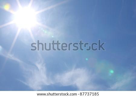 sun in blue day sky - stock photo