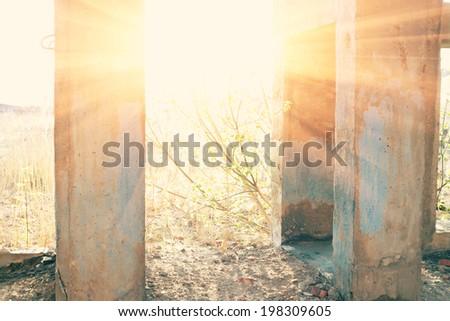 Sun in door of demolished building. - stock photo