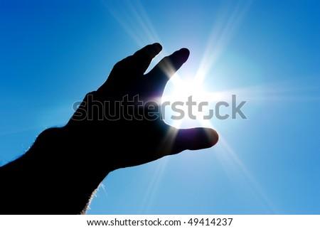 Sun in hand. Conceptual design. - stock photo