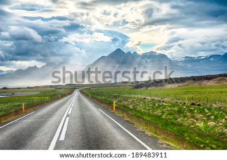 Sun is shining through the clouds on the fjord on the Iceland - stock photo