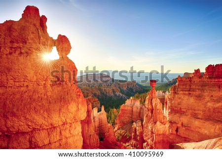 Sun is shining through the rock window in the early morning. Bryce Canyon National Park, Utah, USA.  - stock photo