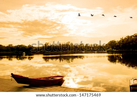 Sun Lake at dusk, located in Sun Island Park, Harbin City, Heilongjiang Province, China. - stock photo