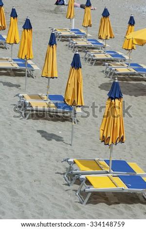 sun lounger and beach umbrella - stock photo