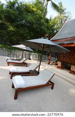 Sun loungers and umbrellas. - stock photo