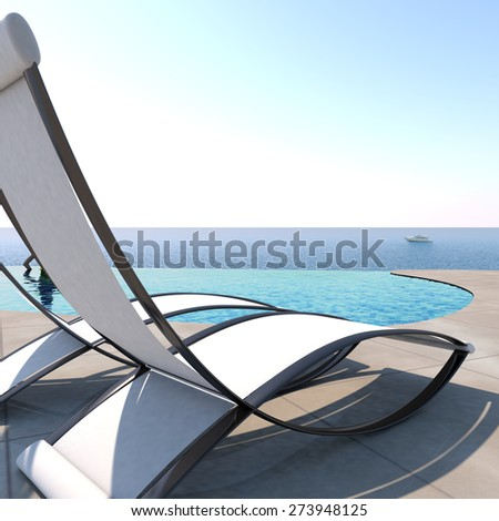 Sun loungers inviting to relaxation and rest near to an infinity pool with panoramic sea view to enjoy life. - stock photo