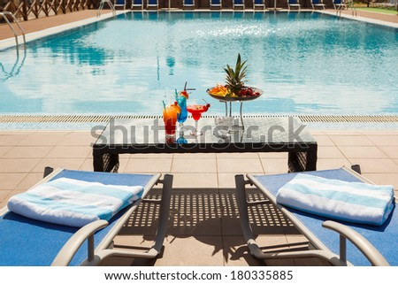 Sun lounges and cocktails by the pool