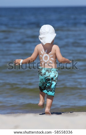 Sun made with suncream. Baby boy and sun protection. - stock photo