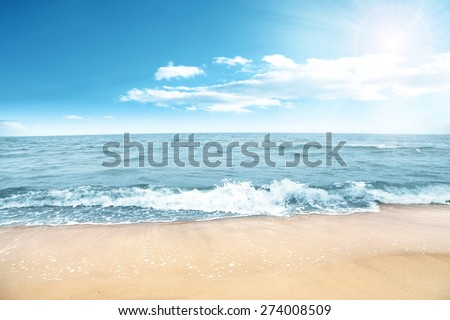 sun of summer time on sky and waves  - stock photo