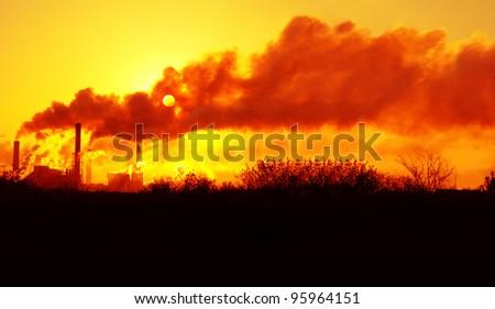 sun on a background of a smoke - stock photo