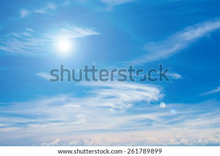 Sun on blue sky with lens flare