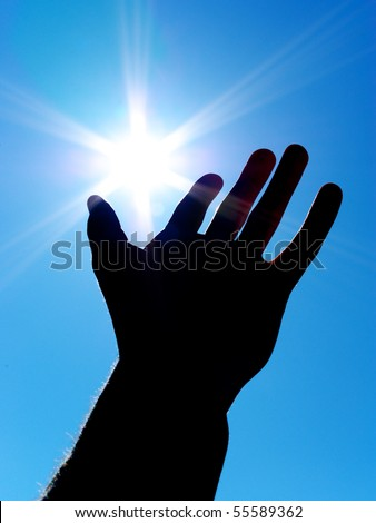 Sun on palm. Silhouette of human hand. Concept design. - stock photo