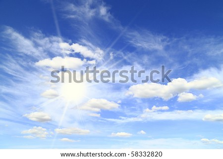 sun on the background of a beautiful sky with white clouds