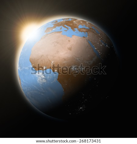 Sun over Africa on blue planet Earth isolated on black background. Highly detailed planet surface. Elements of this image furnished by NASA.
