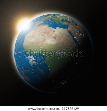 Sun over Africa on blue planet Earth isolated on black background. Highly detailed planet surface. Elements of this image furnished by NASA. - stock photo