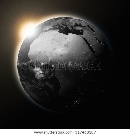 Sun over Africa on dark planet Earth isolated on black background. Highly detailed planet surface. Elements of this image furnished by NASA.
