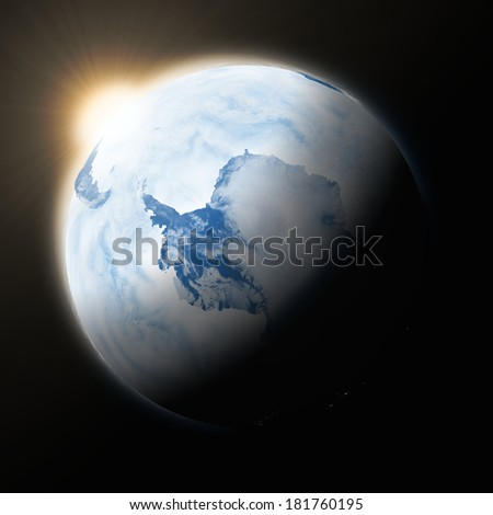Sun over Antarctica on blue planet Earth isolated on black background. Highly detailed planet surface. Elements of this image furnished by NASA. - stock photo