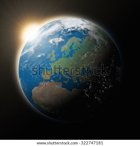 Sun over Europe on blue planet Earth isolated on black background. Highly detailed planet surface. Elements of this image furnished by NASA.