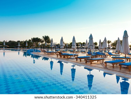 Sun over Hotel Pool  - stock photo