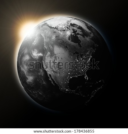 Sun over North America on dark planet Earth isolated on black background. Elements of this image furnished by NASA. - stock photo