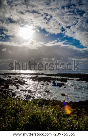 Sun over sharks cove on Oahu's North Shore - stock photo