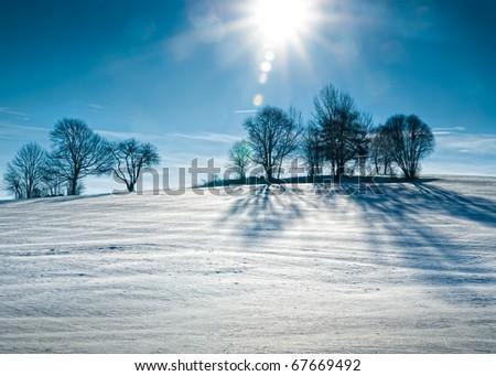 Sun over snowy Hill - stock photo