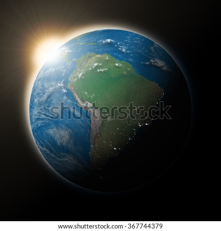 Sun over South America on blue planet Earth isolated on black background. Highly detailed planet surface. Elements of this image furnished by NASA. - stock photo