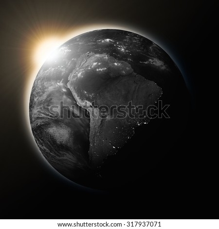 Sun over South America on dark planet Earth isolated on black background. Highly detailed planet surface. Elements of this image furnished by NASA. - stock photo