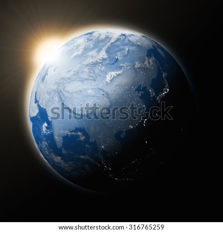 Sun over Southeast Asia on blue planet Earth isolated on black background. Highly detailed planet surface. Elements of this image furnished by NASA. - stock photo