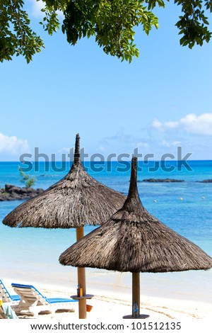 Sun-protection umbrellas, beach, sea. Mauritius - stock photo