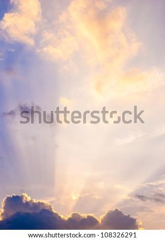 sun ray with yellow-purple sky - stock photo