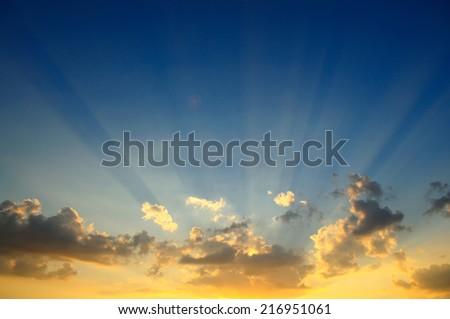 Sun rays at sunset - stock photo