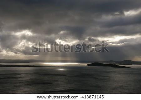 Sun rays before rain, Albany, Western Australia - stock photo