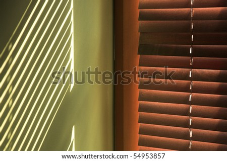 Sun rays come through venetian blind indoor - stock photo