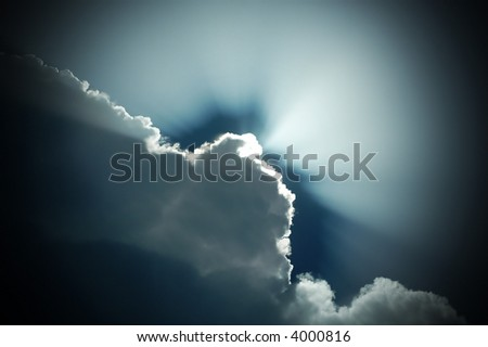 sun rays from the storm cloud - stock photo