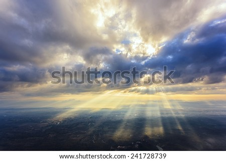 Sun rays landscape from top of mountain - stock photo