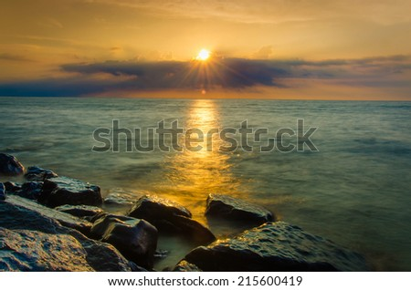 Sun Rays on the Water was created on the rocky beach of Lake Ontario; US side.