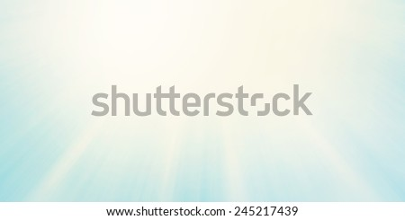sun rays or sun beams background, bright sun shining in the sky, zoomed filter effect, glowing brilliant streaks of light, abstract artsy light blue sky background with yellowed vintage style - stock photo