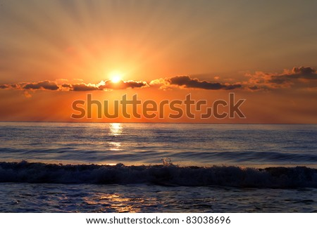 Sun rays over the bulgarian Black sea; Morning seascape with nice clouds. - stock photo