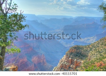 Sun rays over the Grand Canyon - stock photo