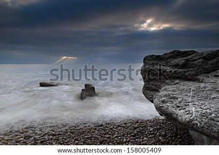 Sun rays over the sea - stock photo