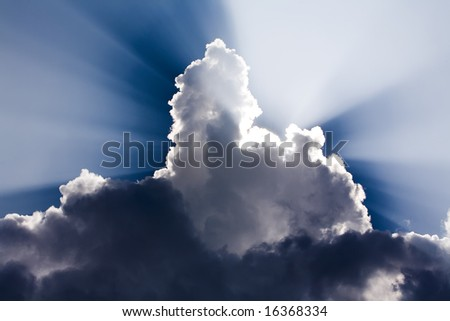 Sun Rays shine through a large cloud - stock photo