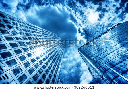 Sun reflecting in modern business skyscraper, high-rise building, architecture raising to the sky Concepts of financial, economics, future etc. - stock photo