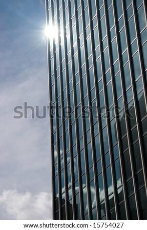 sun reflecting on building - stock photo