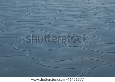 sun reflecting on ice floes with many cracks - stock photo