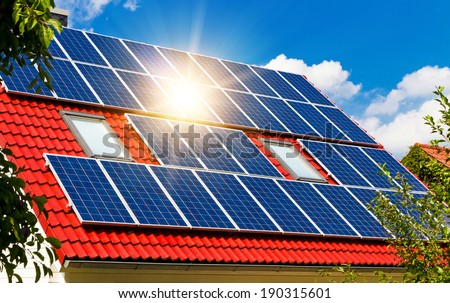 Sun reflection on a solar roof - stock photo