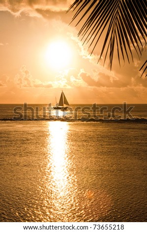 Sun reflection on the sea with yacht on horizon n Rarotonga - stock photo