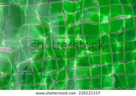 Sun reflections in pool water from above.. Image can be used as background - stock photo