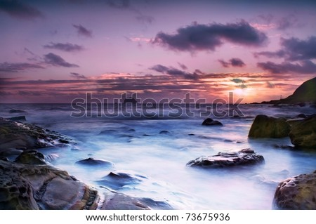 Sun Rise by the coast - stock photo