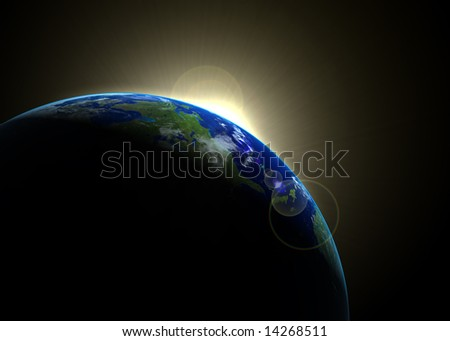 Sun rising against earth